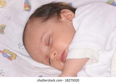 cute baby girl sleeping in her bed