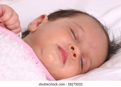 cute baby girl sleeping in her bed
