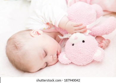 Cute baby girl sleeping in her crib.