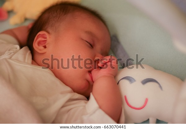Cute Baby Girl Sleeping Next Smiling Stock Photo Edit Now 663070441