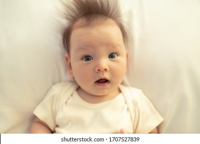 Cute baby girl with surprised look.