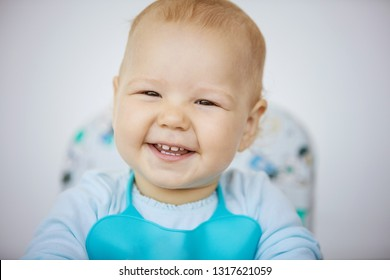 Cute baby girl wearing bib and going to have her meal