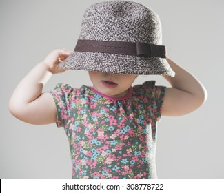 6ff3369af37 cute baby girl wearing an oversized hat
