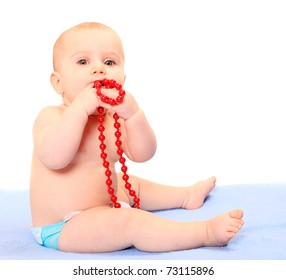 Cute baby with glass necklace.