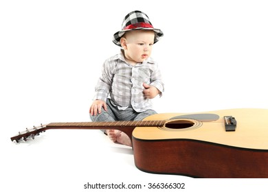 Cute baby in hat with guitar isolated on white background