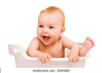 Cute baby having bath in white tub
