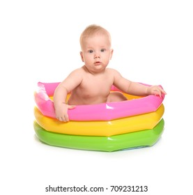 Cute baby in kid inflatable pool, isolated on white