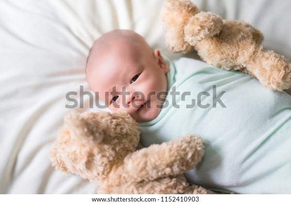Cute baby laying on bed.Newborn sleeping.Two month.Infant