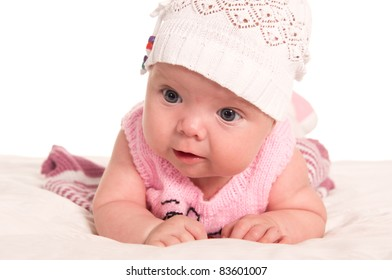 cute baby lying on bed on a white
