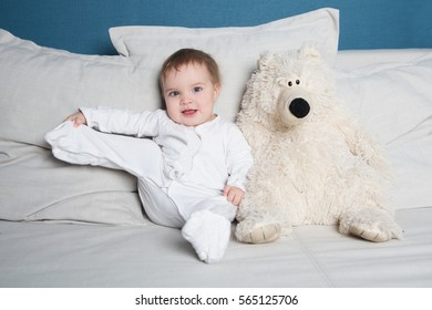 cute Baby lying on  blanket with toy bear