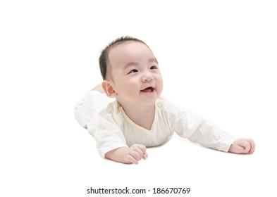 Cute baby lying on white floor