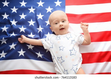 Cute baby on American flag background