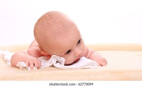 Cute baby on a plushy blanket.