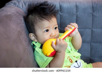 Cute baby on sofa in the room