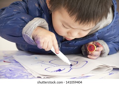 a cute baby is painting