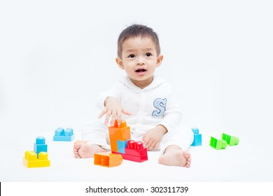cute baby play with toys