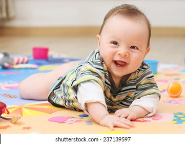 Cute Baby Playing on a colorful Play Mat
