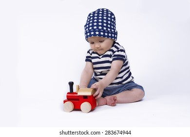 cute baby playing with a red train