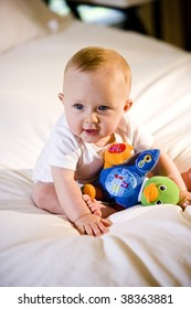 Cute baby playing with a toy
