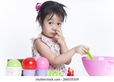 Cute baby playing toys.