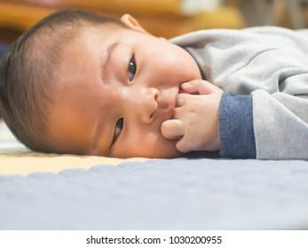 A cute baby portrait, he was sucking fingers.