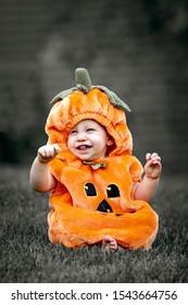 Cute baby in a pumpkin costume