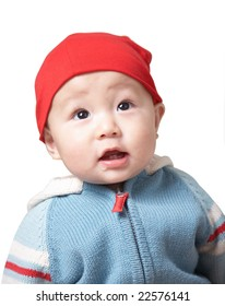 cute baby in a red hat.