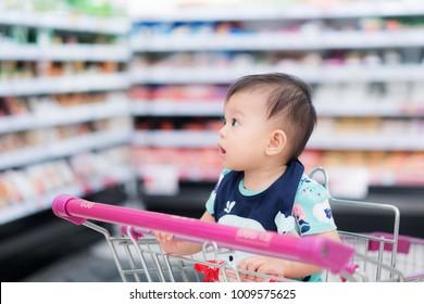 Cute baby in shopping cart