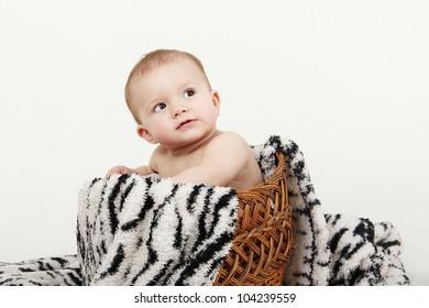 Cute baby sitting on blanket