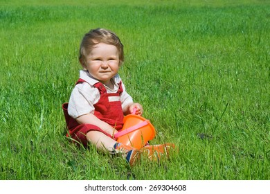 cute baby is sitting on the green grass