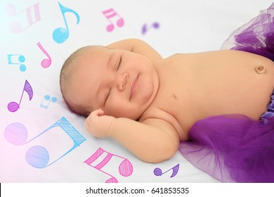 Cute baby sleeping on bed. Lullaby songs and music concept