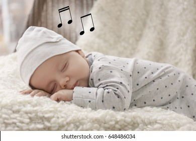 Cute baby sleeping on plaid. Lullaby songs and music concept