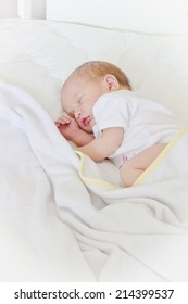 cute baby sleeping peacefully in her crib.copy space background
