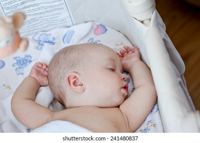 cute baby sleeping sweetly in the cradle at home