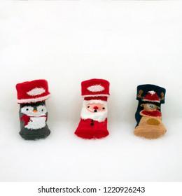 cute baby socks with Christmas motive on white fleece
