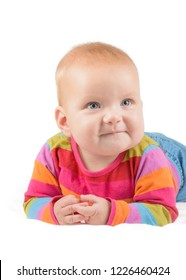 cute baby in stripped shirt smiling