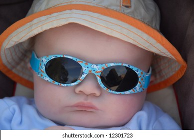 cute baby in sunhat and sunglasses