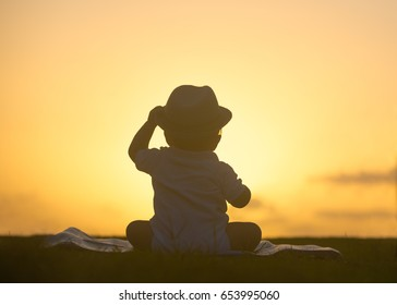 Cute baby sunset silhouette portrait.