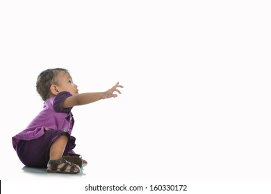 a cute baby is touching something, Isolated over white
