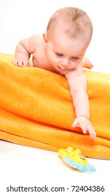 Cute baby with toy.