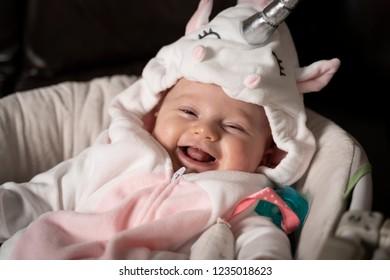 A Cute Baby in a Unicorn Costume