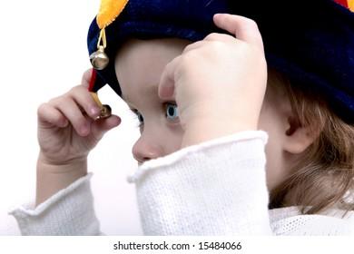 Cute baby wearing funny clown hat