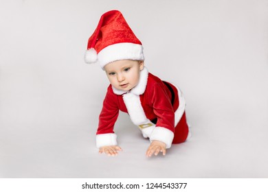 3e648507c Cute baby wearing santa claus costume on a the floor on white background