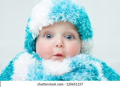 Cute baby at winter background