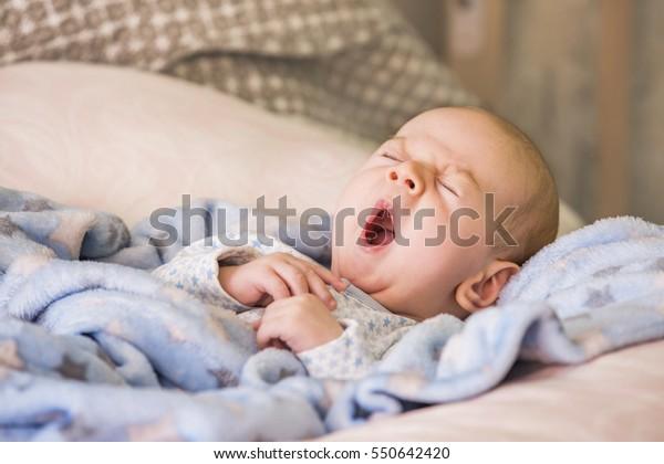 Cute baby yawning before sleep