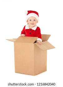 Cute baby-santa with beautiful blue eyes inside the box isolated on white. Christmas, xmas, winter concept. Happy childhood. Santa baby looking at camera from paper box.
