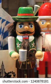 Cute Bavarian nutcracker doll or Christmas nutcracker resembling a typical local from Bavaria in Lederhosen. Wooden handcraft and painted as winter decoration, toy or souvenir Tradition from Germany
