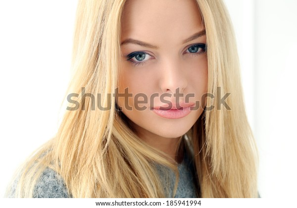 Cute, beautiful girl on a white background