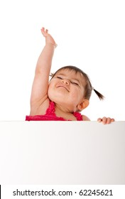 Cute beautiful happy baby infant girl holding white board while reaching up in the air with pride, isolated.