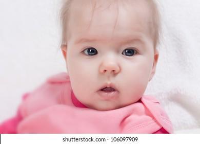 Cute beautiful little girl looking at camera